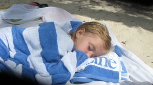 I don't have any recent pictures of myself sleeping on the beach, but you get the idea.